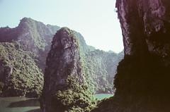 Overlooking Out of Sung Sot Cave (hiphopmilk) Tags: copyright©jaredyehwooehmoehfilms film analog analogue 35mm 135film kodakfilm kodak jaredyeh hiphopmilk nikonfm2 nikonfm2n nikon nikkor vietnam hanoi travel halongbay vịnhhạlong tuần châu sea ocean bay unesco limestone karst island islet sky halong rock