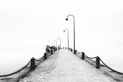 Dinard (Catherine Reznitchenko) Tags: blackwhitephotos bridge silhouette man france streetlamp extérieur seascape bretagne britanny waterfront pont ponton quai noiretblanc lighthouse phare solitude quay illeetvilaine dinard skancheli breizh monochrome minimal