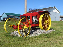 1919 Massey-Harris #1 Tractor (Gerald (Wayne) Prout) Tags: 1919masseyharris1tractor 1919 masseyharris 1 tractor blackrivermatheson taylortownship northeasternontario northernontario ontario canada prout geraldwayneprout canon canonpowershotsx60hs powershot sx60 hs digital camera photographed photography antique historical old farming equipment machine machinery utility display property elmercook blackriver matheson taylor township northeastern northern elmershomestead
