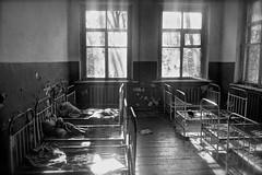 Abandoned Kindergarten, Chernobyl exclusion zone (I M Roberts) Tags: abandonedkindergarten chernobylexclusionzone beds dormitory derelictbuilding fujix100s bw ukraine