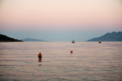 Dusk in Epidavros (athanecon) Tags: epidaurus epidavros greece argolis argolida sea boat sunset colors colours dusk bluehour inthebluehour nikonphotography nikon70300mm nikond750 nikon sky buoy lighthouse light