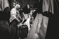 Icons, shopping bags and a disconnected woman (Diggoar) Tags: icon facebook instagram flickr twitter street streetphotography streetscene blackandwhite bw candid candidportrait urbandocumentaryphotography shopping modernlife