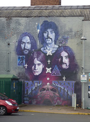 Black Sabbath mural at Birmingham Coach Station (ell brown) Tags: reast digbeth birmingham westmidlands england unitedkingdom greatbritain birminghamcoachstation carpark shortstaycarpark graffiti streetart cityofcolours streetartbrum highvizstreetculturefestival homeofmetal blacksabbath blacksabbath50years ozzyosbourne tonyiommi billward geezerbutler birminghamuk n4t4 wingy