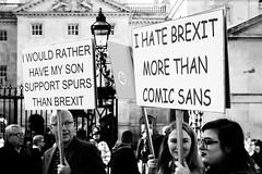 Harsh, But Fair (Sean Batten) Tags: london england unitedkingdom europe brexit march protest signs comicsans font people candid blackandwhite bw city urban fujifilm x100f