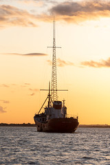 Radio Caroline - Ross Revenge (Dannis van der Heiden) Tags: radio 1368khz caroline north river water sunset sky clouds ship blackwater radioship uk historic radiocaroline radiocarolinenorth livebroadcast live am 1368 khz 648khz 648 sunshine mast mono evening broadcast silhouette radiobroadcast