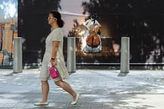 Sidewalk Serenade (ho_hokus) Tags: 2019 fujix20 fujifilmx20 manhattan nyc newyorkcity worldtradecenter advertisement streetphotography woman sidewalk serenade
