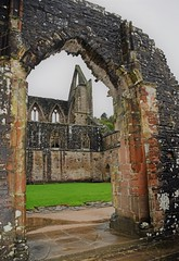 Looking through an archway at Tintern Abbey (Majorshots) Tags: tintern monmouthshire wales tinternabbey