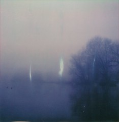 Happy 'Roid Week! :) (mari-ann curtis) Tags: polaroid colour film sx70 light shadows marianncurtis impossibleproject polaroidoriginals polaroidweek winter fog foggy river trees branches reflection water boats purple soft ducks nostalgia