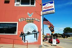 BD's Eagles Nest - Fennimore, Wisconsin (Cragin Spring) Tags: fennimore fennimorewi fennimorewisconsin wisconsin wi midwest unitedstates usa unitedstatesofamerica grantcounty restaurant mural beer beersign sign hamms hammsbeer bar piwo bier flag bdseaglesnest