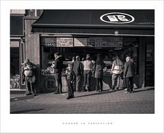 Cooked to perfection (Parallax Corporation) Tags: streetlife streetfood fastfood customers blackwhite streetphotography sonya7r4 sony35mmf18 preston lancashire pedestrianprecinct orchardstreet