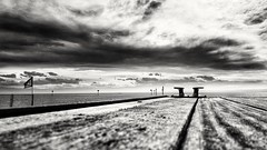 Waiting for a Boat to come... (Ody on the mount) Tags: bw sw monochrome blackandwhite schwarzweis bodensee lake water wasser planken planks himmel sky wolken clouds