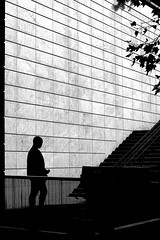 To the wall (pascalcolin1) Tags: paris13 homme man mur wall escalier stairs marches steps lumière light ombre shade photoderue street urbanarte noiretblanc blackandwhite photopascalcolin 50mm canon50mm canon
