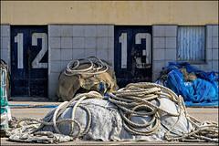 12    13   Blanes, Catalonia (Flemming J. Gade) Tags: nets fishingnets tools portdeblanes blanes