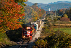 Colors of Clarendon (Wheelnrail) Tags: clarendon pittsford vermont railroad railway vt rutland fall autumn color tree red orange locomotive rails church freight rural green mountains