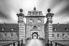 Private Entrance (frank_w_aus_l) Tags: mix castle lembeck architecture sky black blackandwhite noiretblanc decay private entrance arches windows column path d810 pce nikkor nikon symmetry dorsten nordrheinwestfalen deutschland