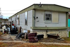 This is a trailer that my sister's family lived in during the 1990s. Today it's empty and surrounded with junk! Wayne (ali eminov) Tags: