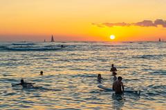 Kuhio Beach Sunset ll (fate atc) Tags: hawaii kuhiobeach pacificocean sunset waikiki water boats surfing swimming yachts