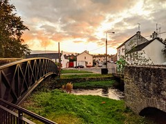 sunset in birr, county offaly (citizensunshine) Tags: ireland ie eire offaly countyoffaly birr camcor river rivercamcor camcorriver bridge bridges sunset town water stream brook orange dusk cloud clouds