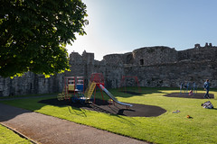 Castle Playground (Jocey K) Tags: unescoworldheritagesite uk june wales moat beaumaris castlebeaumaris triptoukanderoupe2019 sky people building castle playground architecture shadows