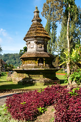 Hindu monument in the landscaped gardens in the Balinese Temple at Lake Bratan (stewart.watsonnz) Tags: temple building garden architecture tower pagoda tree flower grass outdoors old park plant worship landscape landmark outdoor religion placeofworship water noperson historicsite sitting travel botany culture spire ancient front traditional green field monastery small housing buddha botanicalgarden large shrine sky landscaping area vegetation grassy land stone nature finial standing bench