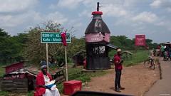 IMGP3294 Coca Cola Kiosk (Claudio e Lucia Images around the world) Tags: cocacola masindi uganda road street people kiosk bottle pentax pentaxkp pentax18135 pentaxcamera pentaxlens pentaxart