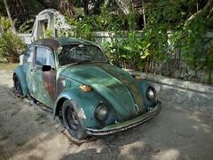 the poor old beetle (SM Tham) Tags: asia southeastasia malaysia kedah langkawi island panjipanjiresort smilingbuffalocafe old car volkswagen beetle signage entrance garden rustic patina wreck junk