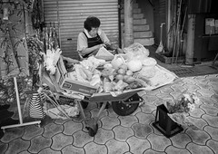 Street Vendor (twomphotos) Tags: okinawa japan sea ocean blue culture nature black white streetphotography people