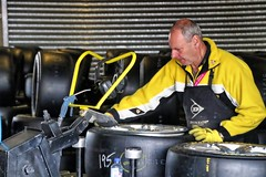 The tyre fitter. (Ian Ramsay Photographics) Tags: bathurst newsouthwales australia australianv8supercarsevent dunlop tyrefitters band transporters tyres race motorsport racingcars replacement