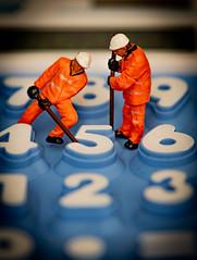 Fixing up the numbers... (Aleem Yousaf) Tags: workers men little macromondays nikon d850 nikkor105mm bokeh macro closeup shallow depth field tabletop mini figures light studio calculator numbers fix creative flickr stationery