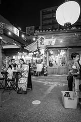 Street Food (twomphotos) Tags: okinawa japan sea ocean blue culture nature black white streetphotography people