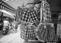 (kuuan) Tags: bw shorts shop voigtländerheliarf4515mm manualfocus mf voigtländer15mm aspherical f4515mm superwideheliar apsc sonynex5n saigon hcmc vietnam street market pattern repeatingpattern