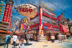 Shinsekai   新世界 (YUSHENG HSU) Tags: architecture area attraction blue blur building cityscape crowd day daytime district editorial exposure famous illustrative japan journey landmark long many motion movement moving naniwa new osaka outdoor outside people place restaurant scene scenic shinsekai shop sightseeing sign signboard sky spot store street sunny tourism tourist travel trip view vivid world 大阪市 大阪府 日本