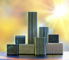 Staple City (Through Serena's Lens) Tags: macromondays stationery staples steel macro aluminum metal art city abstract sunflares tabletop canoneos6dmarkii bokeh