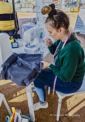 Sowing is her craft (Kool Cats Photography over 12 Million Views) Tags: oktraveltakeover route66 topaz event craftshow downtown festival oklahoma oklahomacity outdoors photography ricohgrii streetphotography traveloklahoma sewing crafts clothing