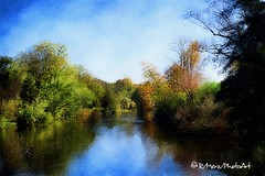 Beside a Flowing River... (ImproVisions) Tags: fall forest fallcolors digitalart digitalpainting appart trees painterly woodland woods seasons photoart impressionistic photoedit mobileart ipadart reflections textures riverbank riverscape