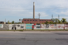Commissioners Street (Gary Kinsman) Tags: commissionersstreet portlands toronto canada ontario canoneos5dmarkii canon5dmkii empty open industrial postindustrial topographics newtopographics wires cables empy urbanlandscape canon35mmf2 2019 urban skyline wasteground pylon thehearn hearngeneratingstation powerstation richardlhearngeneratingstation decommissioned abandoned derelict decay graffiti posters chimney cloud overcast