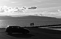 Over to North Wales (ronramstew) Tags: westkirby wirral merseyside marina autumn 2019 northwales wales car couple coast bw blackandwhite