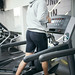 Fit young man caucasian running on machine treadmill workout in gym