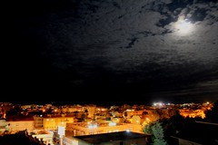 silent moon (Silvia Bergamaschi) Tags: city night lights moon clouds houses