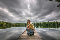 Contemplation (Mark Polson) Tags: dock sarona wi clouds thinker reflection