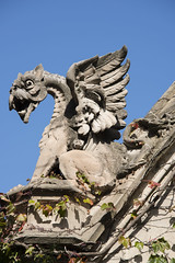 rooftop gargoyle (Cat Girl 007) Tags: ancient architecture bluesky chimera cobbgate decoration demon devil dragon gargoyle gothic monster mythical mythological old outdoor rooftop sculpture sitting statue stone wings