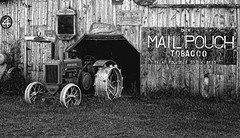 Relics preserved on a rural Boswell, IN farm (Jack Blackstone) Tags: barn boswell indiana leicaq2 mailpouch on1 rural us41 johndeere monochrome blackandwhite lightroom sep2 americana history preservation tractor hoosier farm old weathered backroads caughtmyeye fantasticmonday retro iconic