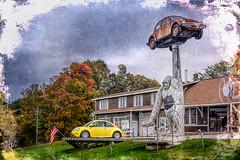 Roadside Distraction (Wes Iversen) Tags: htt nikkor18300mm rutland texturaltuesday vermont volkswagen apes autumn autumncolor buildings cars gorilla rust statues texture trees windows