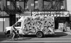 East Broadway (neilsonabeel) Tags: nikonfm2 nikon blackandwhite eastbroadway manhattan newyorkcity bike graffiti van mural street sign nikkor