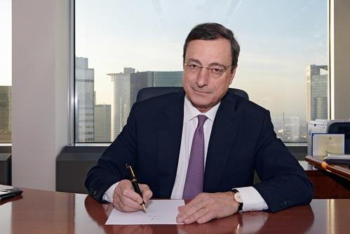 Mario Draghi signing banknotes