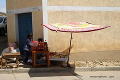 A square flat umbrella over the street stall - Sunday Market Tarabuco Chuquisaca Bolivia (WanderingPJB) Tags: flickruploaded umbrella southamerica latinamerica bolivia tarabuco sundaymarket bazaar chuquisaca streetstall square flat