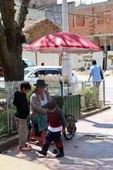 Red umbrella over the popcorn - Vallegrande Santa Cruz Bolivia (WanderingPJB) Tags: flickruploaded umbrella southamerica latinamerica bolivia santacruz vallegrande popcorn stall