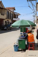 A green umbrella over the street food stall - Vallegrande Santa Cruz Bolivia (WanderingPJB) Tags: flickruploaded umbrella southamerica latinamerica bolivia santacruz vallegrande streetfood stall green