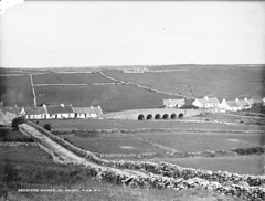 Moher in the sunshine. (National Library of Ireland on The Commons) Tags: glassnegative robertfrench williamlawrence nationallibraryofireland lawrencecollection lawrencephotographicstudio thelawrencephotographcollection bridge arches moher cottages coclare peatsmoke roadford aille