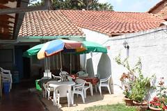 Outdoor seating area - La Chakana Restaurant - Samaipata Bolivia (WanderingPJB) Tags: flickruploaded umbrella southamerica latinamerica bolivia samaipata lachakanarestaurant outdoor seatingarea